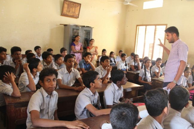 Extention programme on importance of SSLC exam by II B.Com B2 student at olakadu high school